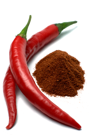 red chili pepper: Red chili peppers and chili powder isolated on white
