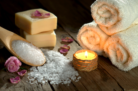 spa still life: Spa still life with towels and candle Stock Photo