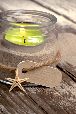 tealight: Tealight glass and starfish on sandy wooden boards