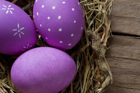 macroshot: Colourful easter eggs in a nest Stock Photo