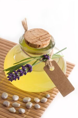 Lavender oil isolated on white with cardboard and copy space