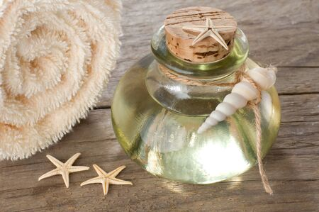 Essential oil with towel and starfishes Stok Fotoğraf