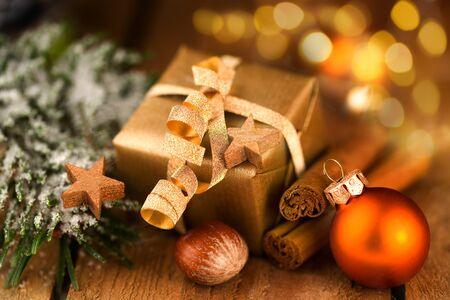 Golden Christmas gift with bokeh effect