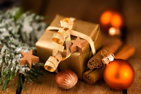 Golden Christmas gift with decoration Stok Fotoğraf