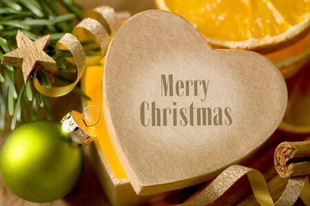 Heart-shaped Christmas gift with lettering Merry Christmas Stok Fotoğraf