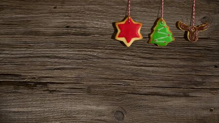 Christmas background with colorful cookies and copy space