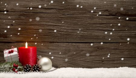 Snowy Christmas background with present and falling snowflakes