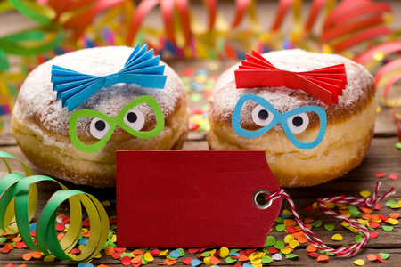 Carnival doughnuts with funny faces and copyspace Stok Fotoğraf