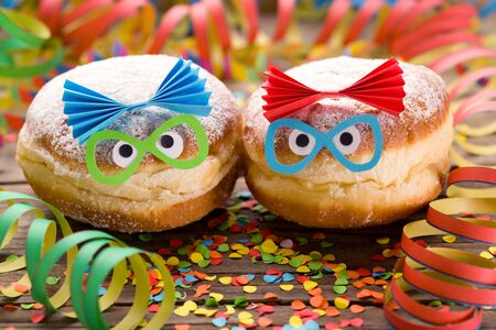 Carnival doughnuts with funny faces Stok Fotoğraf