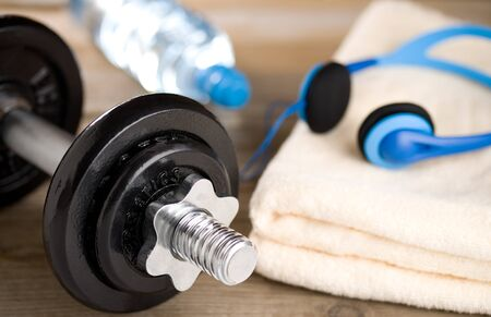 Fitness equipment - dumbbell, towel and water
