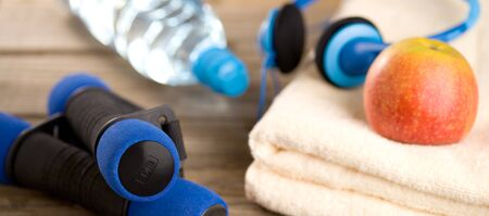weight reduction plan: Fitness equipment - dumbbells and towel Stock Photo