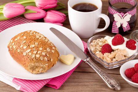 Richly laid breakfast table in springtime Stok Fotoğraf