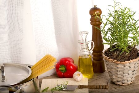 Cooking with fresh rosemary and vegetables