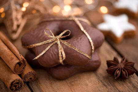 Christmas still life with gingerbread stars and spices on wood Stok Fotoğraf - 88543445