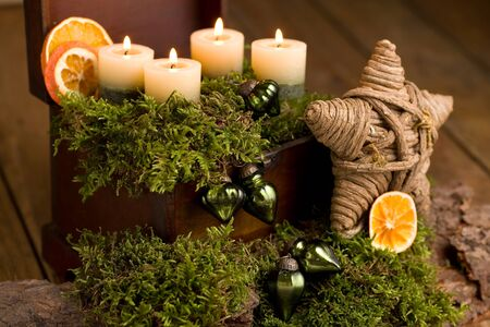 Advent arrangement with candlelight on wood Stok Fotoğraf - 91476375