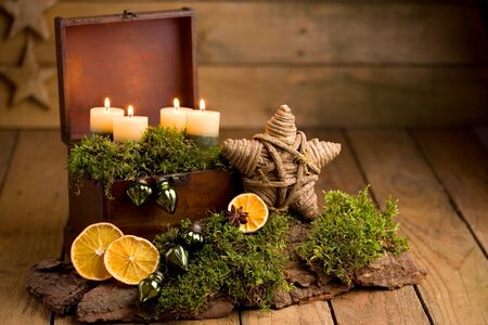 Advent arrangement with candles and orange slices Stok Fotoğraf
