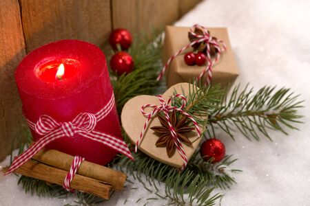 Christmas decoration - candle and cute presents in the snow Stok Fotoğraf - 91242483