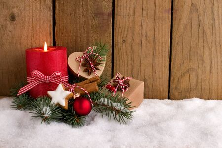 Christmas decoration - Red candle and cute presents in the snow Stok Fotoğraf