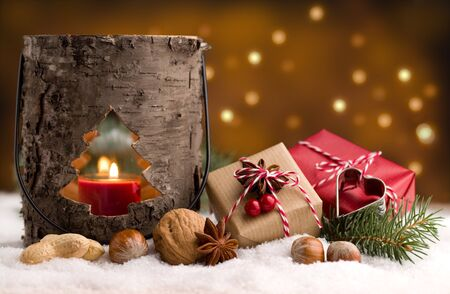 Christmas decoration - Cute presents and wooden lantern in the snow Stok Fotoğraf