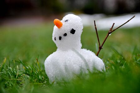 Small snowman braves the thaw period Stok Fotoğraf