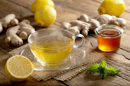 Hot Ginger Lemon Tea on rustic wooden table with mint leaf Stok Fotoğraf
