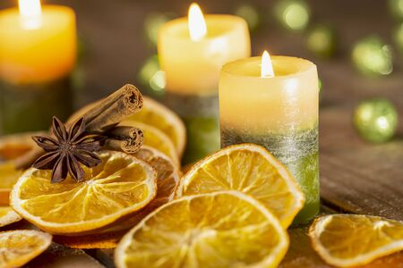 Christmas decoration - candles, spices and orange slices for third sunday in Advent