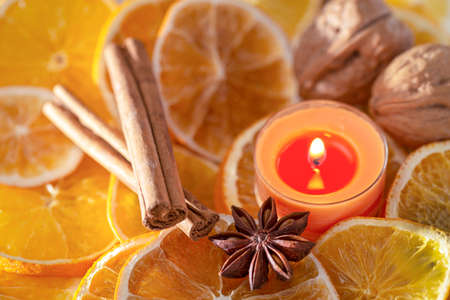 Christmas decoration - orange slices, candle and Christmas spices