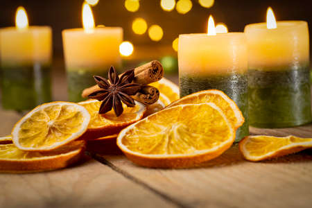 Christmas decoration with candles and orange slices - fourth Sunday of Advent