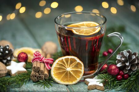 Mulled wine with orange slices, spices and fir cones on wood Stok Fotoğraf