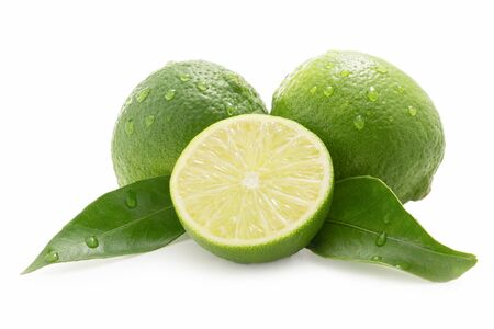 Sweet limes - one sliced - with drops of water isolated against white