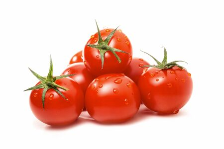 Ripe tomatoes with drops of water isolated