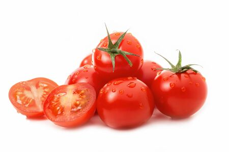 Ripe tomatoes - one sliced - with drops of water isolated