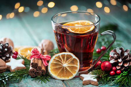 Mulled wine with Christmas spices on turquoise old wood