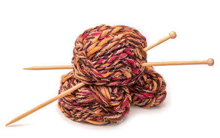 Knitting - balls of wool with needles isolated against white