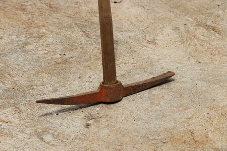 Pickaxe with flat and sharp edge on either sides which is a hand tool to dig holes in ground Stock Photo