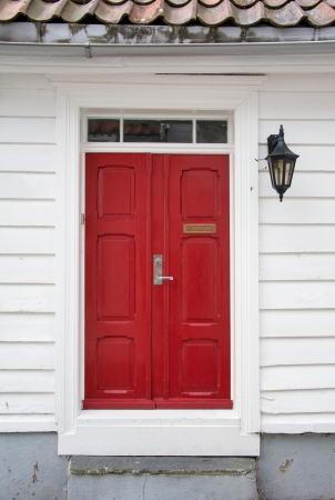 Red door in old european house photo