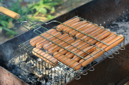 Grilled sausages on brazier photo