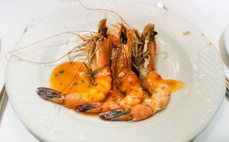 fishery products: Shrimps on a white plate with sauce