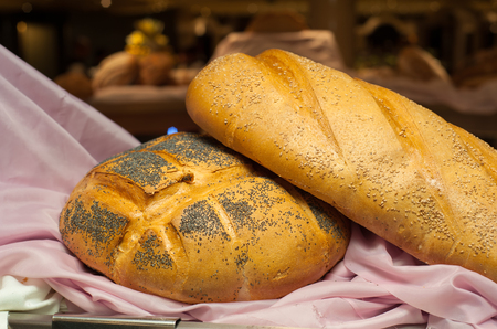 crusty french bread: Fresh bread lying on the table
