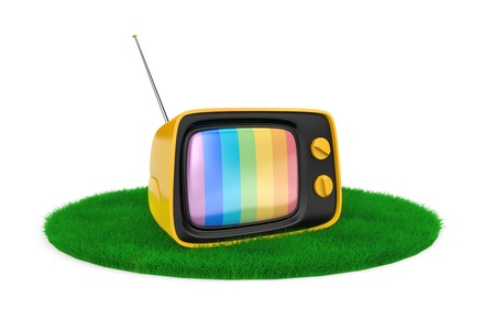 Retro TV on the grass. Isolated on white Banque d'images