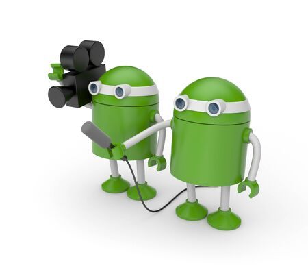 interviewer: Green robots, one holding a video camera, the other holding the microphone. This team of robots symbolizes reporters,the interviewer and the operator. Stock Photo