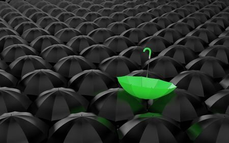 A huge number of open black umbrellas, on top of which lay a green umbrella photo