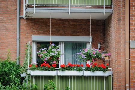 balcony window: Balcony with flowers in Europe