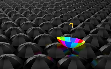 Huge number of open black umbrellas, on top of which lay a rainbow umbrella