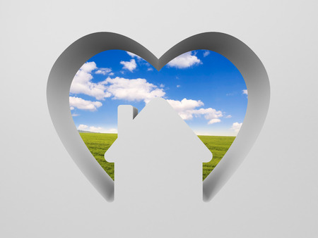 Shape of heart with house and the scenery inside. Sweet home. Heart red. The landscape is depicted field with lawn and blue sky photo