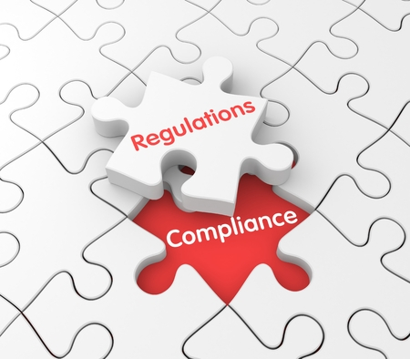 compliance: Background consisting of puzzles, one puzzle which is detached from the other