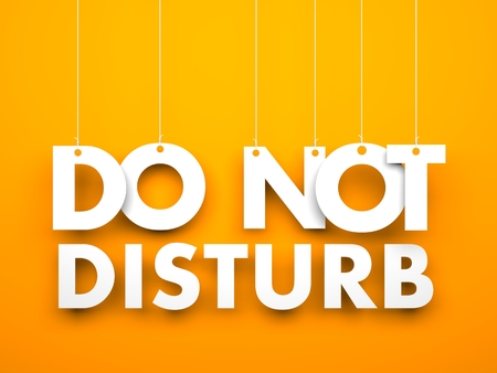 Orange background with hanging letters which make up the sentence - Do not disturb