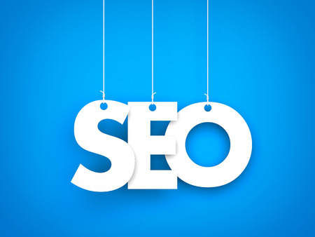 meta tags: Seo word suspended by ropes on blue background