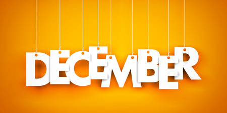december: December. Text hanging on the strings