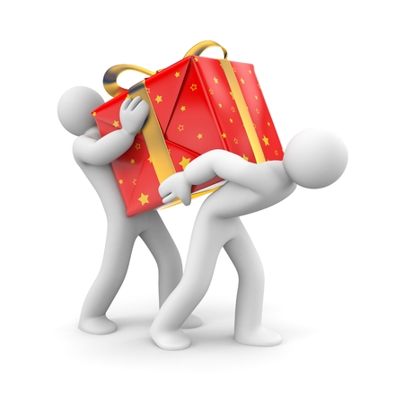 Two people together carry the heavy gift Stock Photo